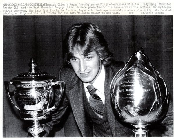 Wayne Douglas Gretzky with Lady Byng Trophy and Hart Trophy
