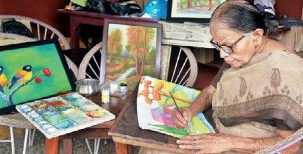 Age is never a bar for Padmini she regularly practices art strokes with brush on paper