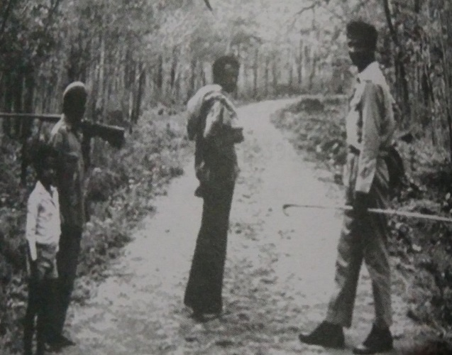 Chinnappa in the forest with the Jenu Kurubas, the local tribesmen reputed for their skill in collecting honey and forest produce