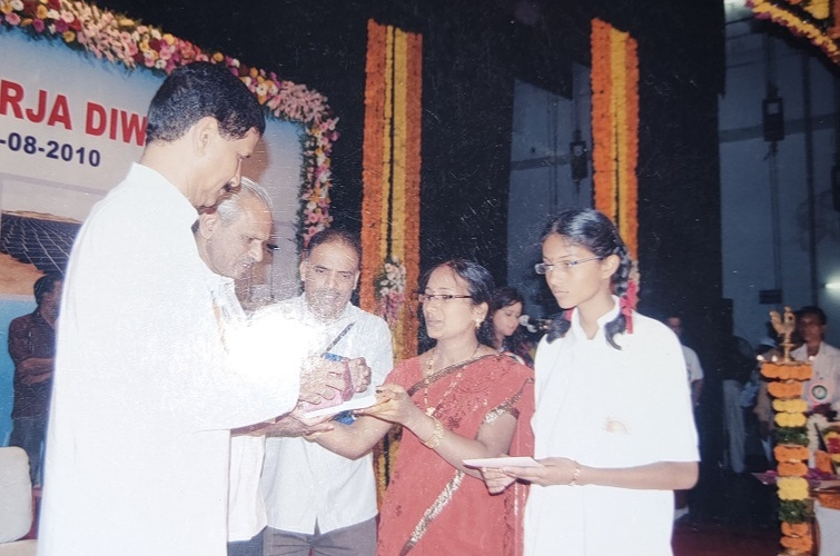 Receving prizes for Rajiv Gandhi Akshaya Urja Divas Event-State level Drawing Competition
