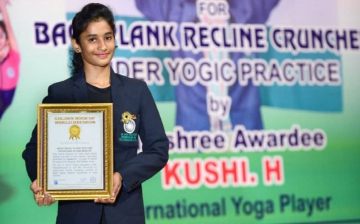 Khushi creating a Golden Record in Performing the Toughest, hardest Yoga asanas - Niraalamba Poorna Chakrasana 15 times under 1 minute while she was only 13 years