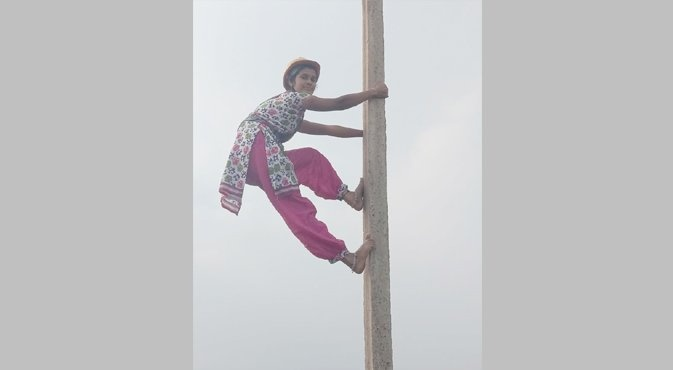 Sirisha climbed up and down the pole in less than a minute
