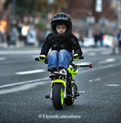 Tima Kuleshov is a 7-years-old sports star from Ukraine who drives a mini car, a motorcycle, skis, and does trampoline