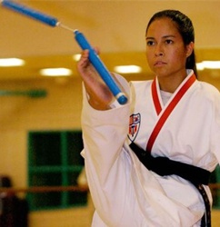 Training in Taekwondo at the age of 10 in her hometown of Sierra Vista and achieved black belt at the age of 14