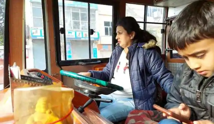 Pooja held the steering wheel of the passenger bus and drove passengers on the Jammu-Kathua road with her younger son innocently seated next to her