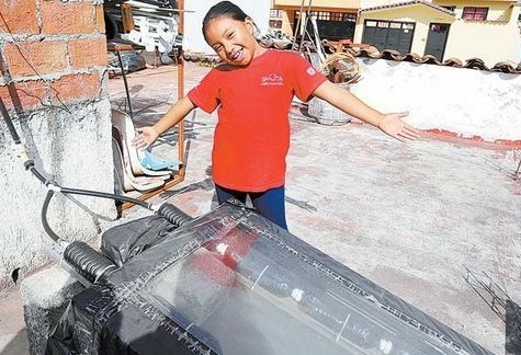 Xóchitl developed a solar water heater from recycled materials and installed it on the roof of her house