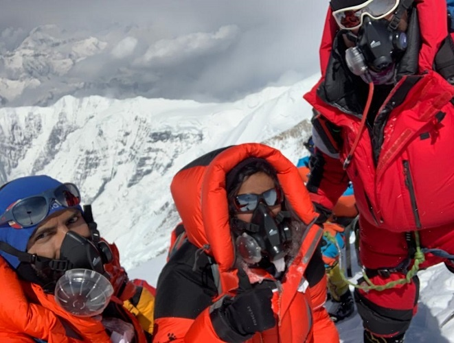 Under the leadership of the veteran Sherpa guide, she finished her journey to the summit