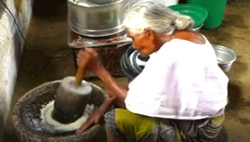 She then grinds coconuts, salt and adds other ingredients to them to prepare mouth-watering chutney in a traditional hand grinder